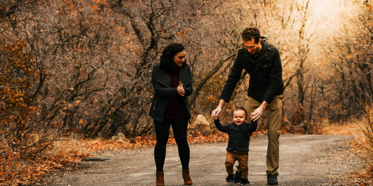 Mom, Dad, and Baby walking