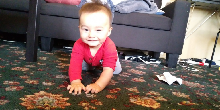 Baby crawling and smiling